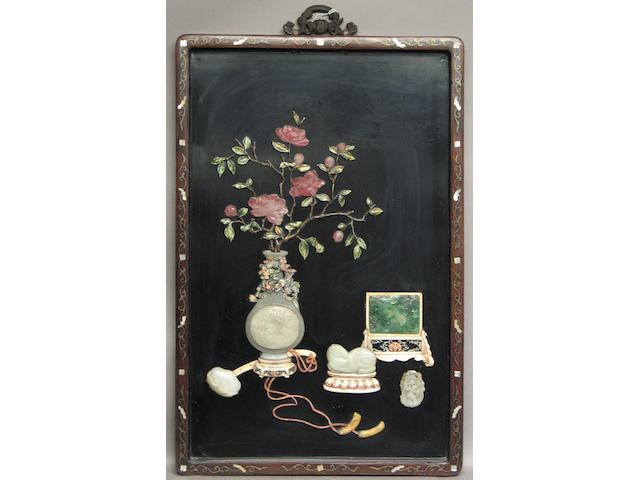 A framed black lacquered wood wall panel with ivory and colored stone inlay