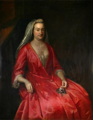 Circle of John Verelst (active 1698-1734 London) A portrait of a lady in a red gown, thought to be Mrs. Francis Holloway 50 1/2 x 40 1/4in