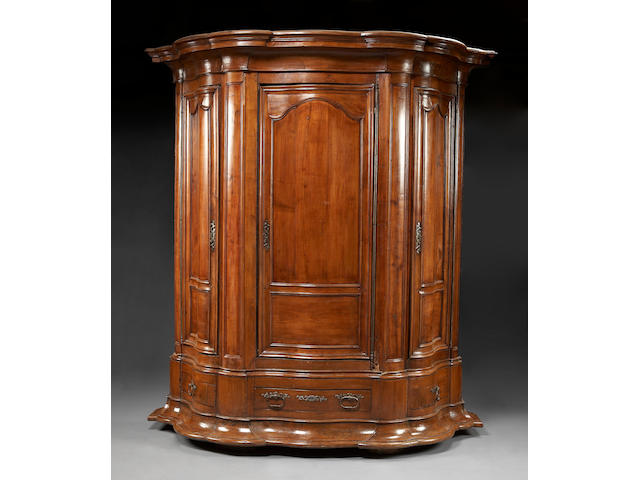 An imposing Régence cherry triple armoire
