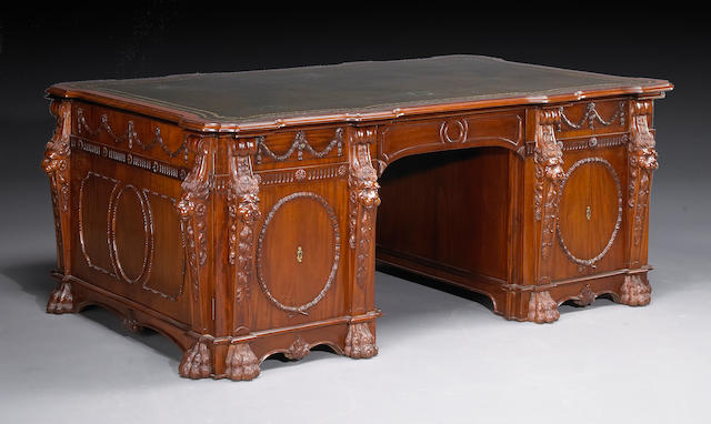 A George III style mahogany partner's desk, in the manner of Thomas Chippendale