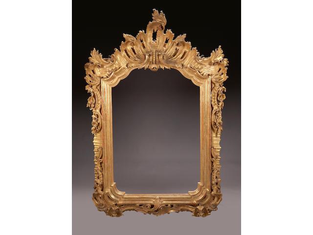 A very fine Venetian Rococo style giltwood mirror