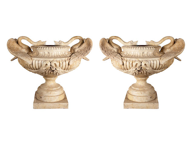 A pair of imposing Neoclassical style travertine urns