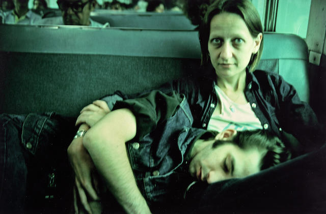 Nan Goldin (American, 1953) Suzanne and Philippe on the train, Long Island, 1985 16 x 20in (40.6 x 50.7cm)