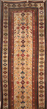 A Malayer runner Central Persia, size approximately 3ft. 4in. x 12ft. 2in.