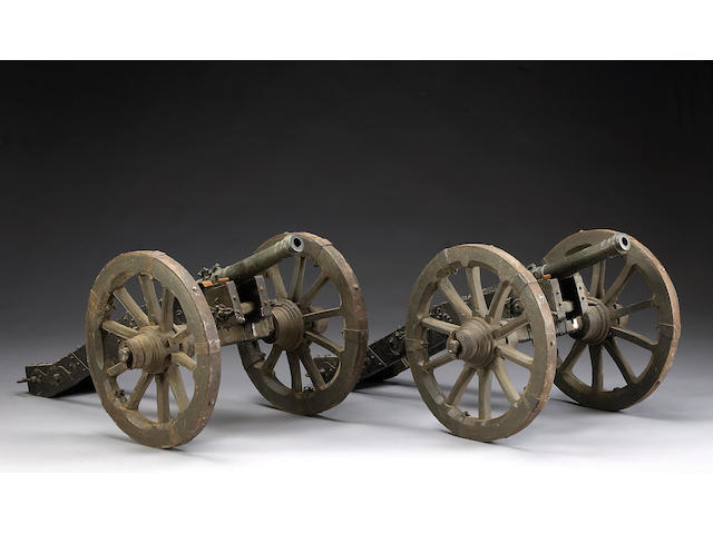 A pair of bronze cannons with associated field carriages