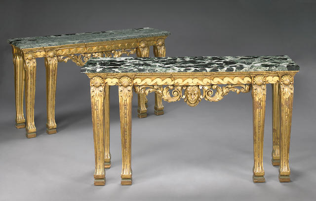 A pair of Regency style giltwood console tables