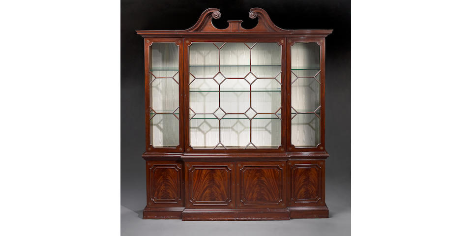 A George III style inlaid mahogany breakfront bookcase