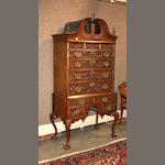 A Chippendale style walnut bonnet top chest of drawers
