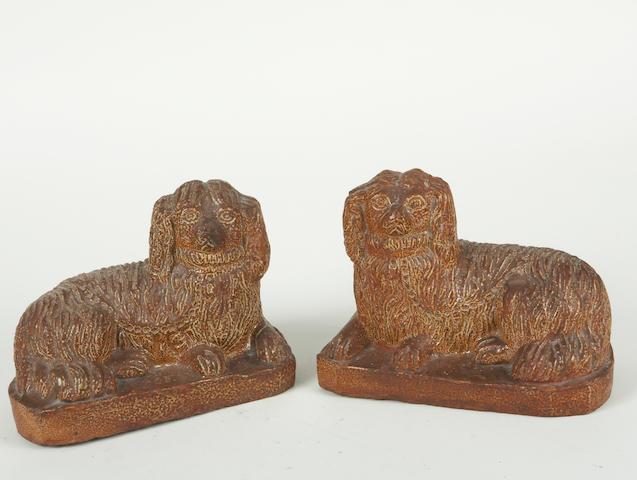 A pair of English salt glazed earthenware spaniels