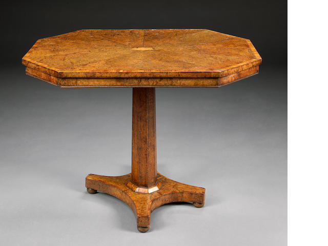 A Regency inlaid pollard oak center table