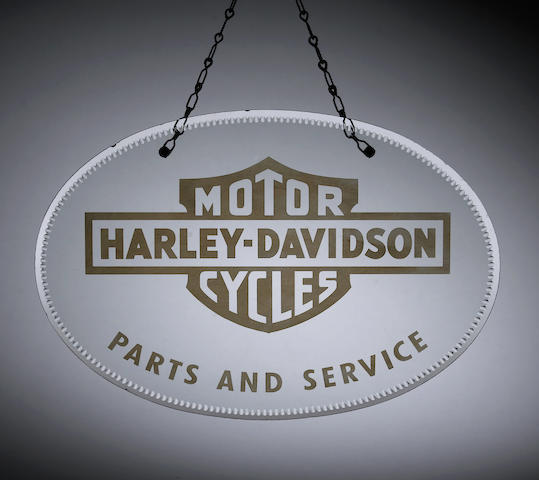 A Harley Davidson Parts and Service glass showroom sign,