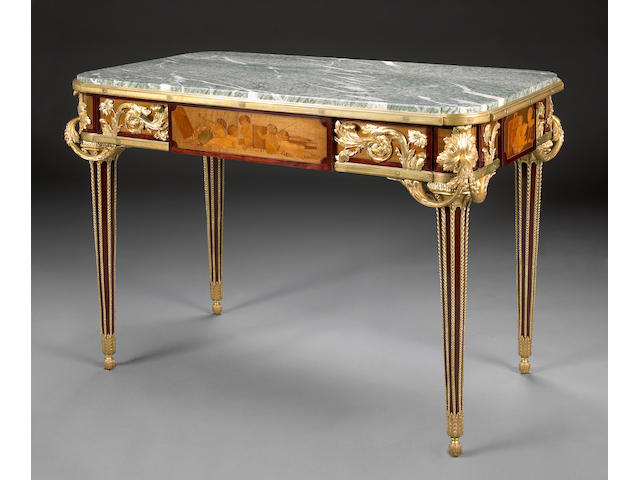 A Louis XVI style gilt bronze mounted marquetry center table