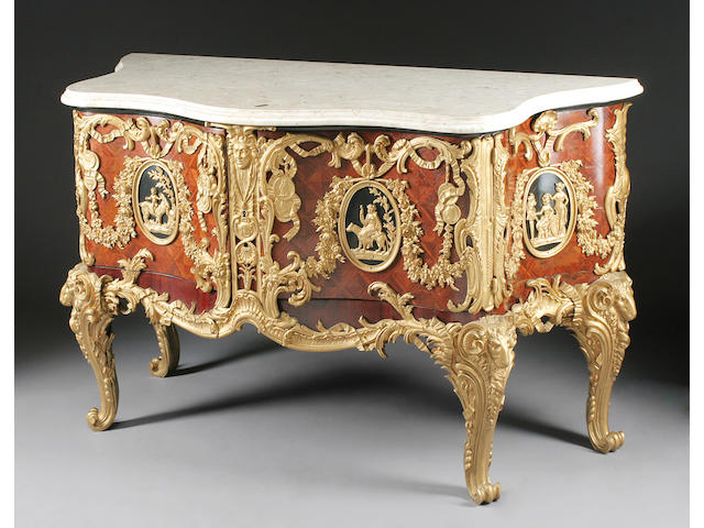 A French gilt bronze mounted parquetry inlaid walnut commode