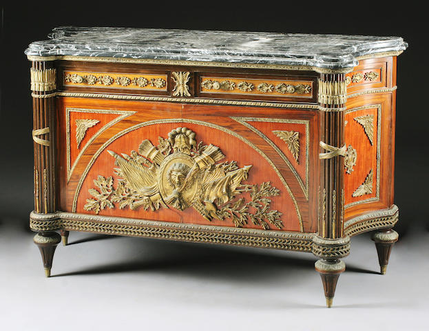 A Louis XVI style gilt bronze mounted kingwood commode