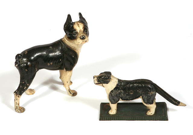 A cast iron paint decorated door stop in the form of a Boston Terrier