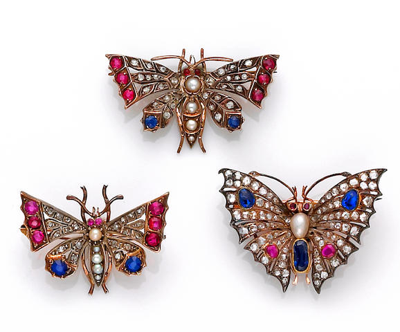 Three antique diamond and gem-set butterfly brooches,
