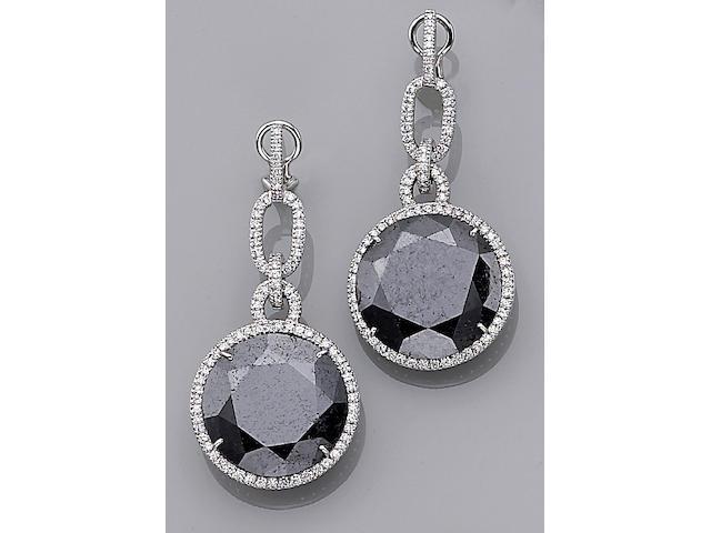 A pair of black diamond and diamond pendant earrings