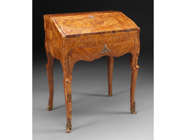 A Continental Rococo kingwood parquetry desk on frame