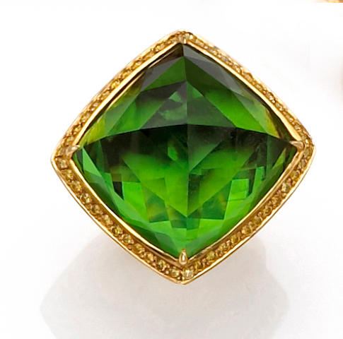 A peridot and colored diamond ring