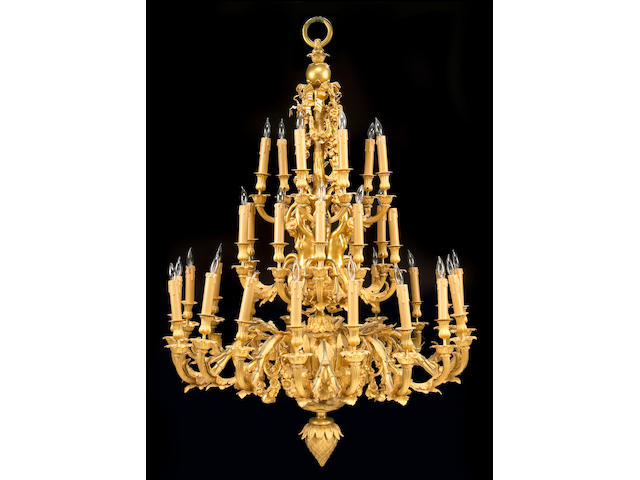 A Louis XV style gilt bronze thirty three light chandelier