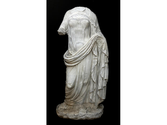 A carved marble figure of a classical maiden