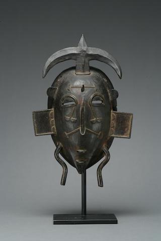 A Senufo bronze facemask