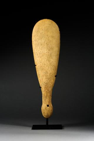 A large Maori whalebone hand club