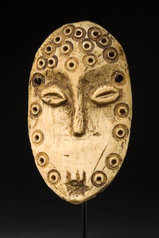 A fine Lega ivory maskette, Lukungu