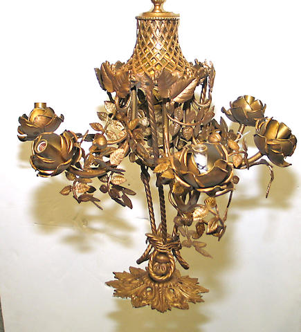 A Rococo floriform gilt metal six light chandelier