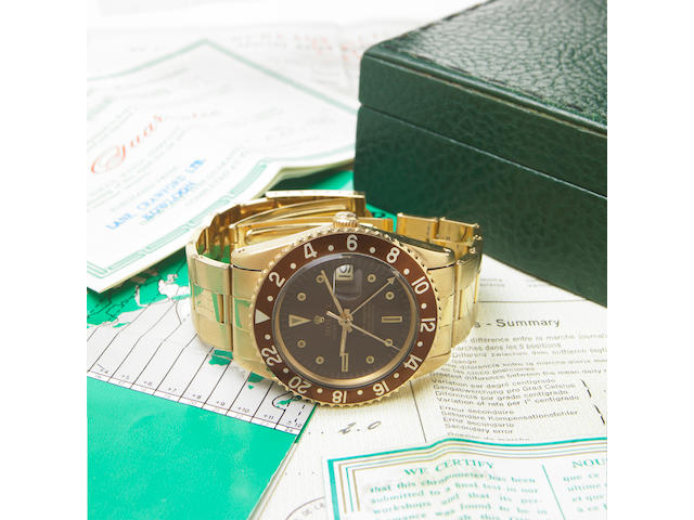 Rolex. A fine and rare 18k gold self-winding dual-time zone calendar wristwatch on associated 18k riveted link bracelet with Rolex presentation case, punch-numbered chronometer certificate, punch-numbered and dated original guarantee and GMT instruction bookletOyster Perpetual GMT Master, Ref.1675, Case No.1467520, made in 1965, sold on March 12, 1968