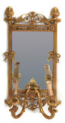 A pair of Louis XVI style two light mirrored wall appliques
