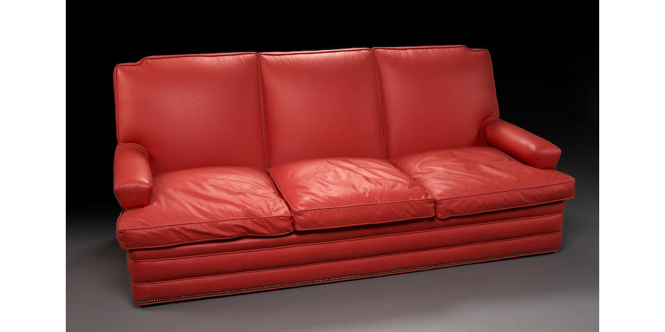 An Art Deco lipstick red leather upholstered sofa
