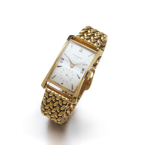Patek Philippe & Co., A fine 18k gold flared rectangular wristwatch on associated 18k gold bracelet Ref.1593, Case No.649.839, Movement No.970.016, made in 1947, sold on June 21st, 1948