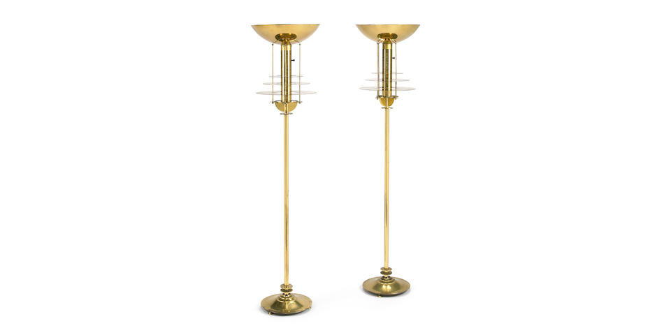 A pair of Walter von Nessen brass floor lamps