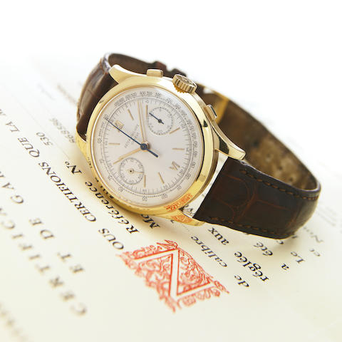 Patek Philippe. An extremely fine and rare 18k gold oversize chronograph wristwatch with original gu