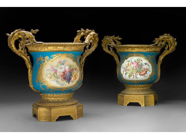 A pair of Sèvres style porcelain gilt bronze mounted jardinières