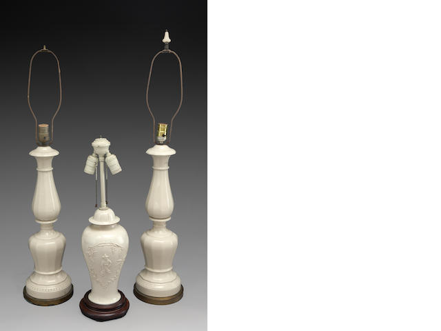 An assembled group of three cream glazed earthenware table lamps