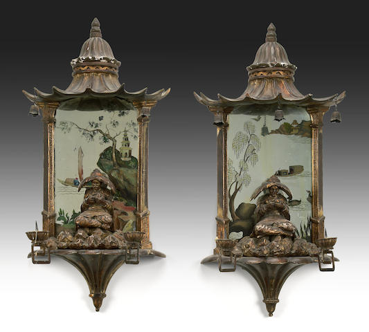 A pair of Chinoiserie pagoda form two light mirrored sconces