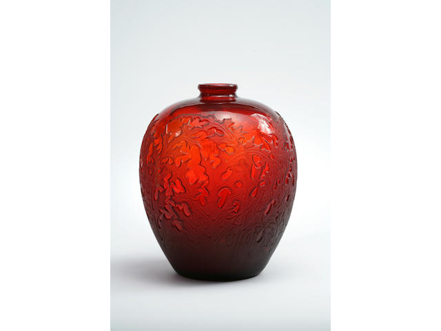 A René Lalique molded red glass vase: Acanthus