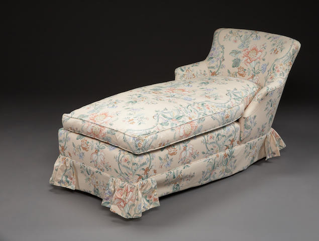 A peach chintz upholstered chaise lounge