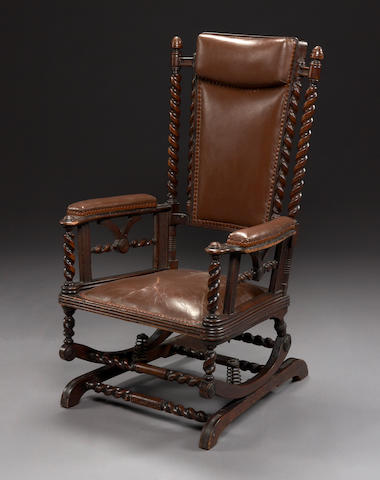 An American Renaissance Revival walnut and leather rocking chair