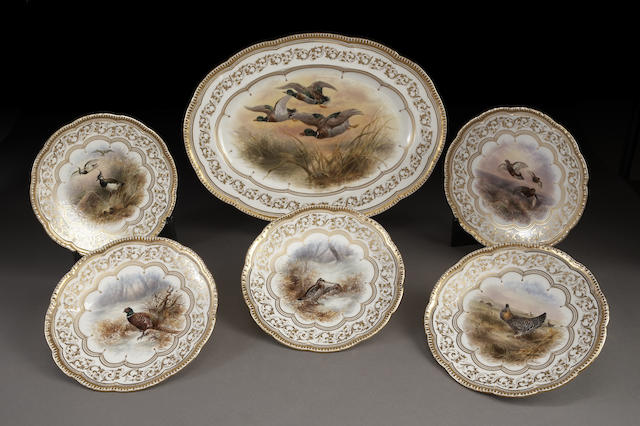 A set of eleven English porcelain ornithological plates and platter