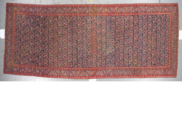 A Northwest Persian long carpet Northwest Persia, size approximately 7ft. 3in. x 17ft.