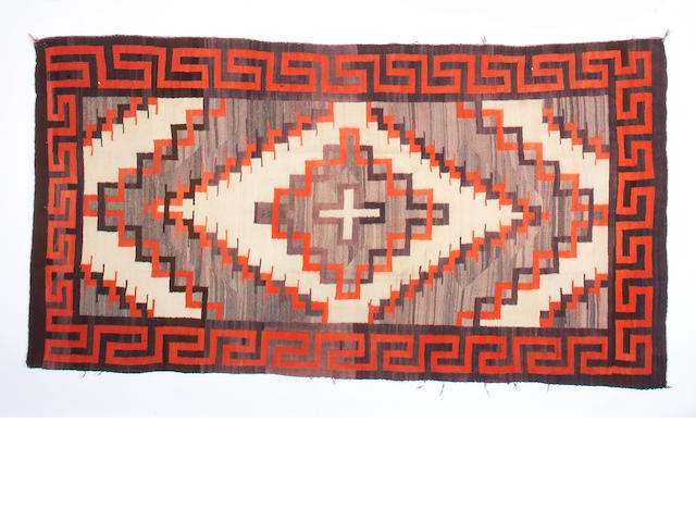 A Navajo transitional rug, 9ft 2in x 5ft 2in
