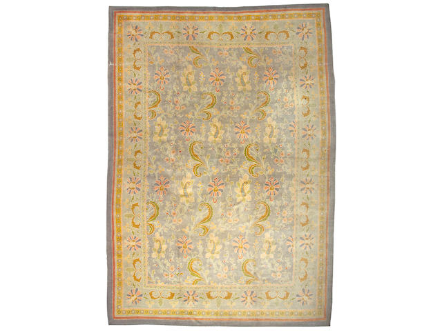 A Donegal Arts and Crafts carpet Ireland, size approximately 11ft. 11in. x 18ft.