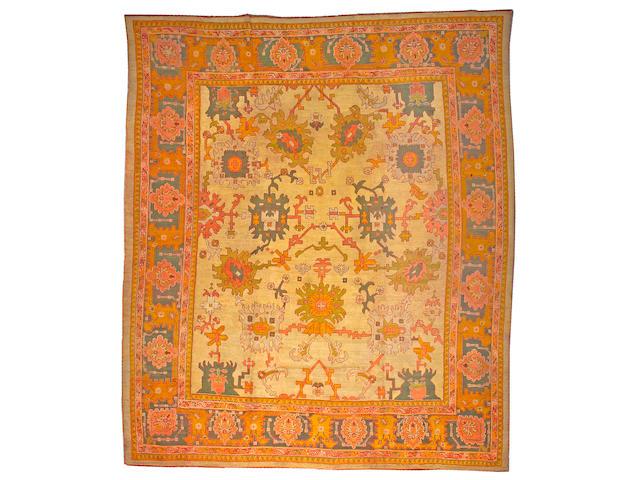 An Oushak carpet West Anatolia, size approximately 12ft. x 14ft.
