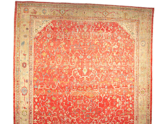 An Oushak carpet West Anatolia, size approximately 16ft. 4in. x 23ft. 10in.
