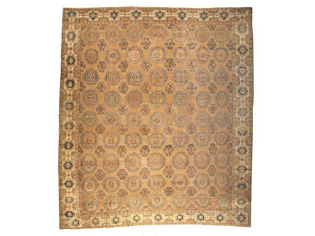 A Khotan carpet Turkestan, size approximately 13ft. 6in. x 15ft. 4in.