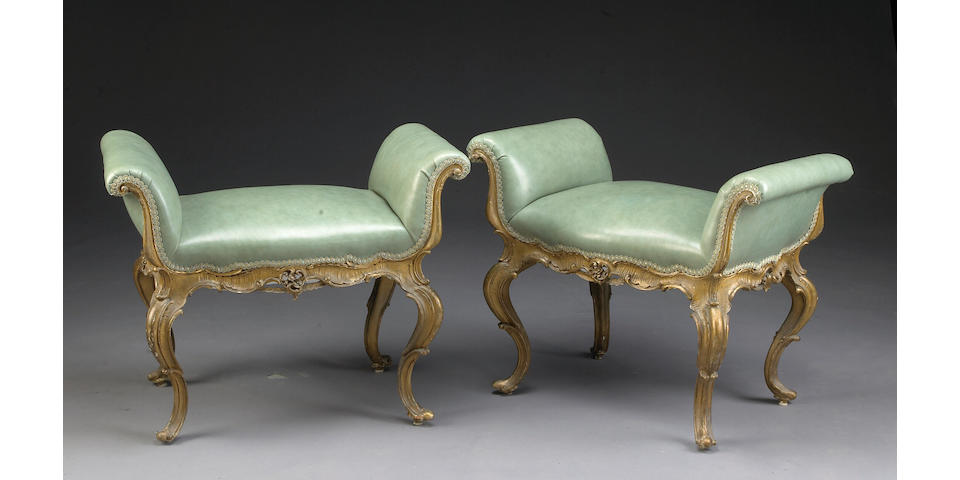 A pair of Rococo style giltwood window seats