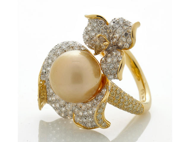 A South Sea cultured pearl, diamond and colored diamond ring